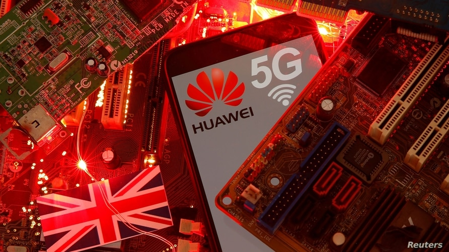 FILE - The British flag and a smartphone with a Huawei and 5G network logo are seen on a PC motherboard in this illustration picture taken January 29, 2020.