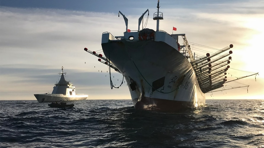 """Handout picture released by Argentina's Navy press office showing the ARA """"Bouchard"""" Ocean Patrol escorting a Chinese flag…"""