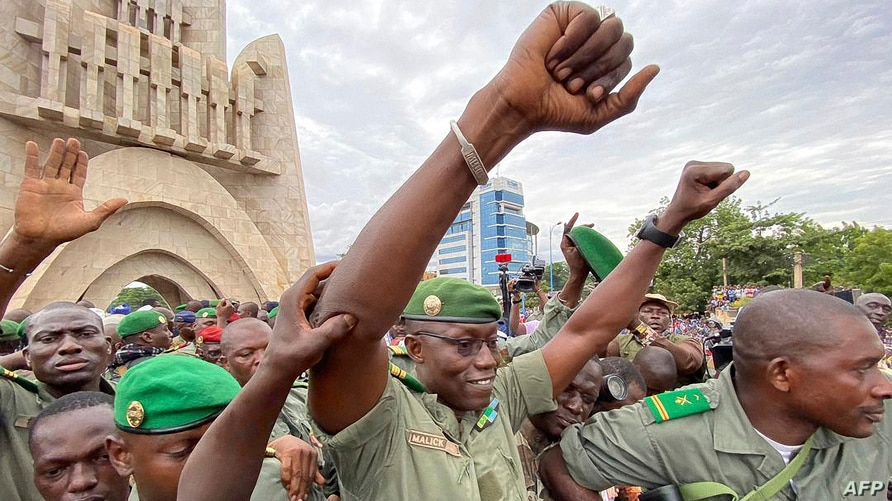 Colonel Malick Diaw (C), vice-president of the CNSP (National Committee for the Salvation of the People) gestures to a crowd.