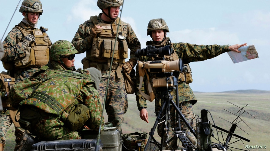 Soldiers from U.S. Marines and Japan's Ground Self-Defense Force attend their joint exercises that are intended to recover an…