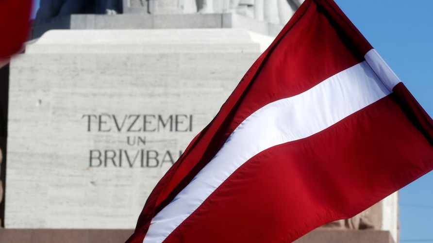Latvia's national flag flutters next to the Freedom monument in Riga, Latvia March 16, 2018. REUTERS/Ints Kalnins