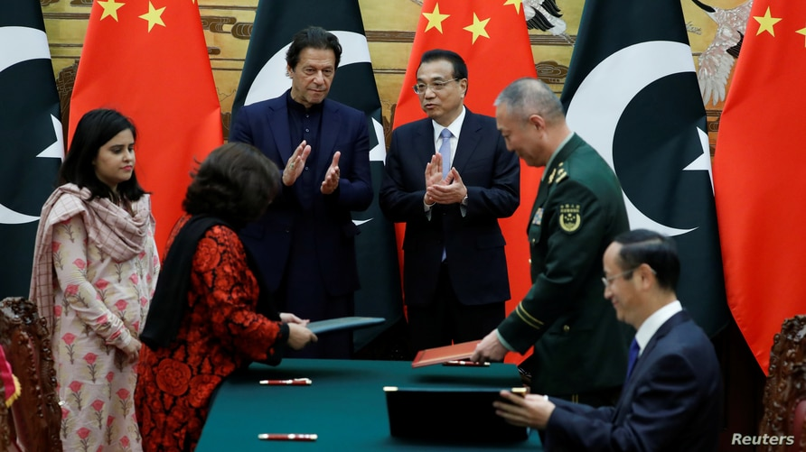Pakistan's Prime Minister Imran Khan and Chinese Premier Li Keqiang attend a signing ceremony at the Great Hall of the People…