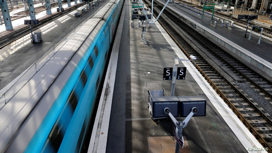 A TGV high-speed train operated by state-owned railway company SNCF speeds at Bordeaux railway station during a strike by…