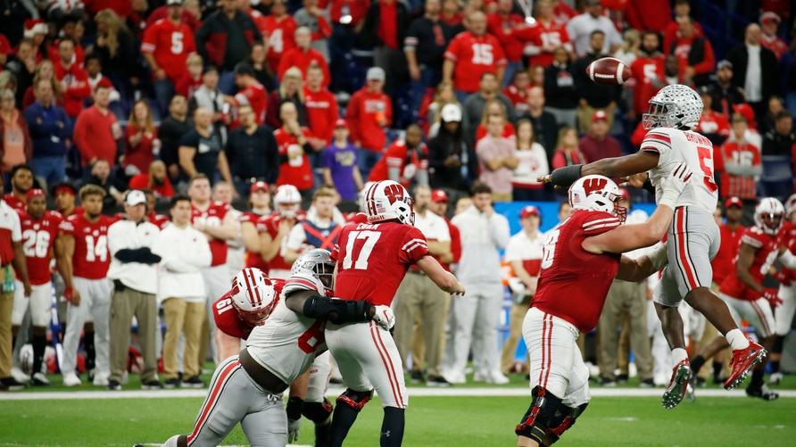 Dec 7, 2019; Indianapolis, IN, USA; Wisconsin Badgers quarterback Jack Coan (17) throws a pass that is batted down by Ohio…