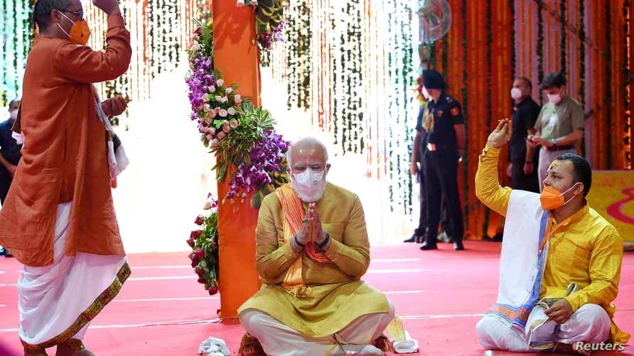 India's Prime Minister Narendra Modi attends the foundation-laying ceremony of a Hindu temple in Ayodhya, August 5, 2020. India…