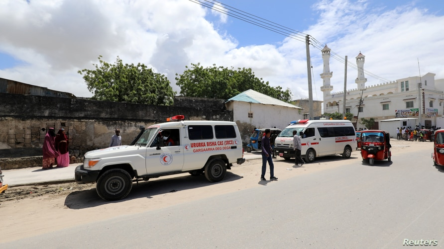 An ambulance is seen near a blast site that rocked a military base in Mogadishu, Somalia August 8, 2020.