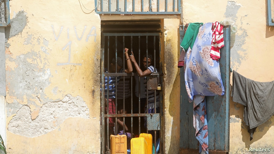 Inmates are seen at the Mogadishu central cell in Mogadishu, Somalia July 20, 2019. Picture taken July 20, 2019. REUTERS/Feisal…