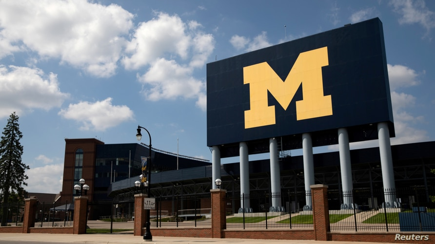 FILE PHOTO: An empty Michigan Stadium is seen on the University of Michigan campus amid reports of college football…