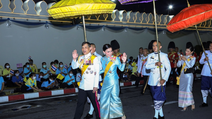 Thailand's King Maha Vajiralongkorn and Queen Suthida wave to well-wishers after a ceremony to celebrate the brithday of Queen…