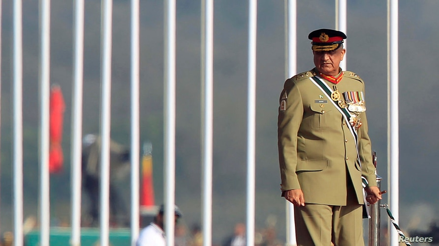 FILE - Pakistan's Army Chief of Staff Lieutenant General Qamar Javed Bajwa arrives to attend the Pakistan Day parade