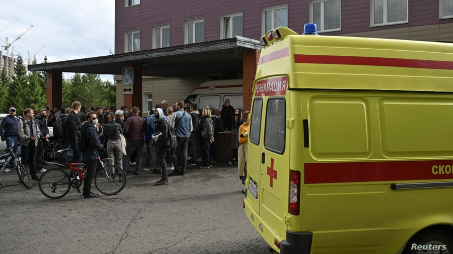 People gather outside a hospital, where Russian opposition leader Alexei Navalny receives medical treatment in Omsk, Russia…