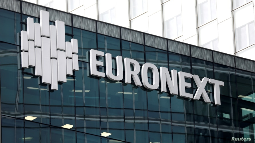 FILE PHOTO: The logo of stock market operator Euronext is seen on a building in the financial district of la Defense in…