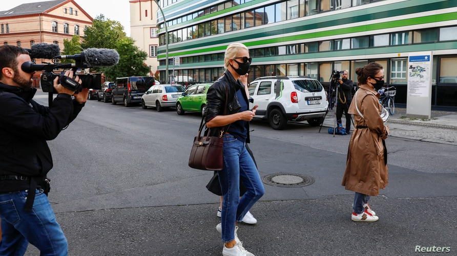 Yulia Navalnaya, wife of Russian opposition leader and President Vladimir Putin critic Alexei Navalny, arrives at the Charite Mitte Hospital Complex, in Berlin, Germany, Aug. 25, 2020.