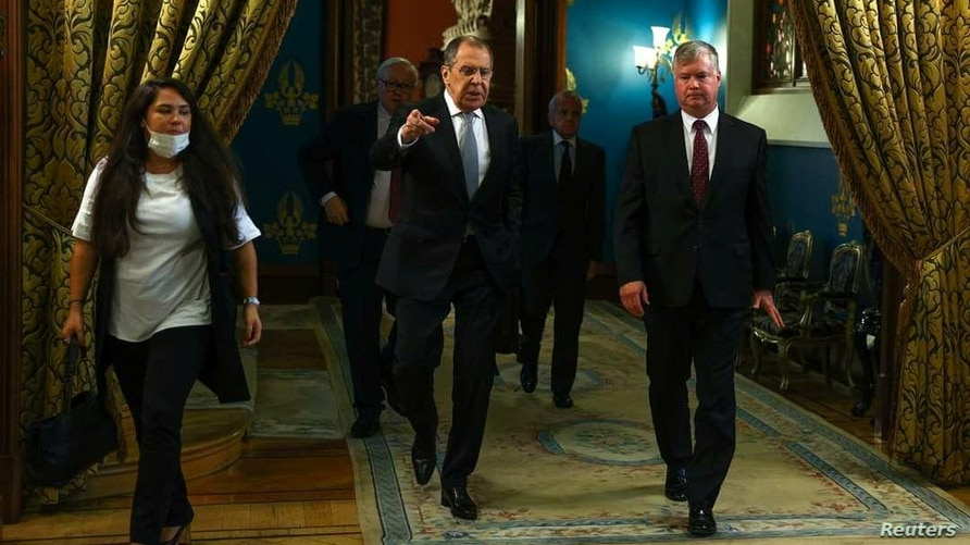 Russian Foreign Minister Sergei Lavrov and U.S. Deputy Secretary of State Stephen Biegun walk during their meeting in Moscow,…