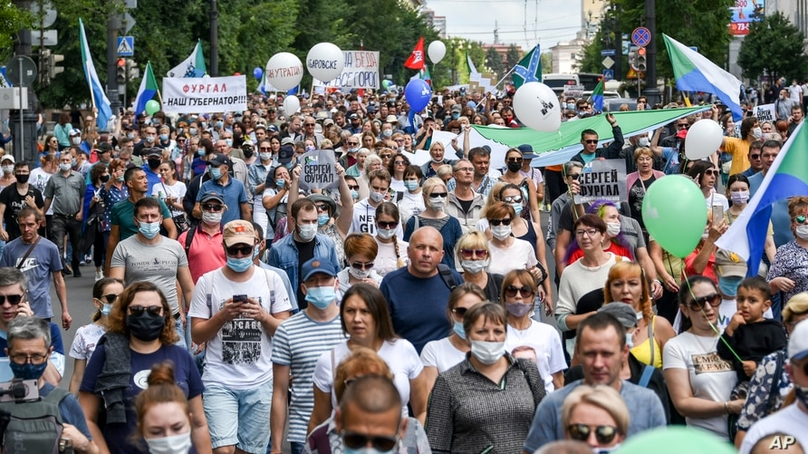 "People hold posters that read: ""I am, We are Sergei Furgal, Sergei Furgal our Governor"", during an unsanctioned protest in support of Sergei Furgal, the governor of the Khabarovsk region, in Khabarovsk, 6100 kilometers east of Moscow, Aug. 8, 2020."