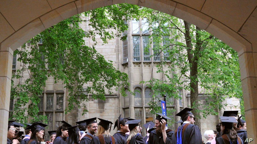 FILE - In this May 24, 2010 file photo, future graduates wait for the procession to begin for commencement at Yale University…