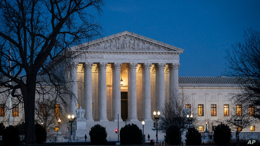 Night falls on the Supreme Court in Washington, Wednesday evening, Jan. 22, 2020, as Chief Justice John Roberts presides in the…