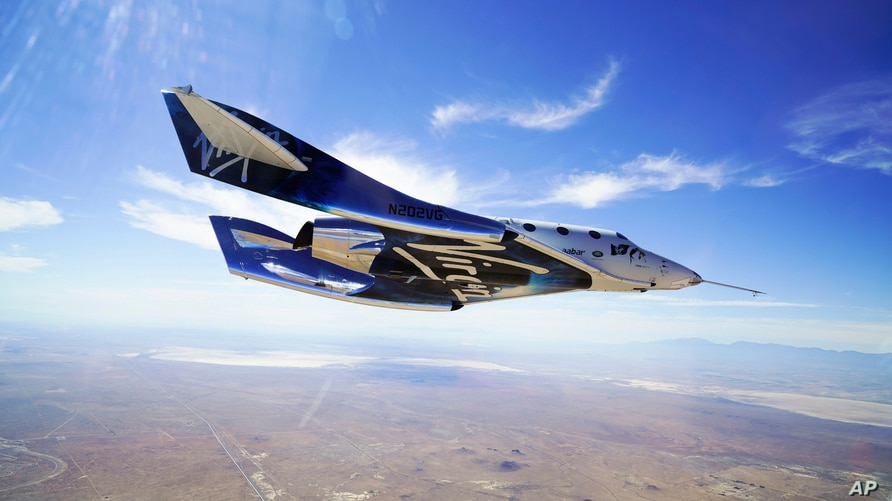 FILE - In this May 29, 2018 photo provided by Virgin Galactic, the VSS Unity craft flies during a supersonic flight test.