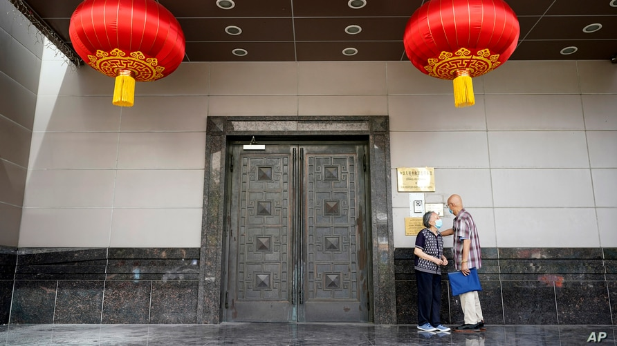 Visitors try to enter the Chinese Consulate General Wednesday, July 22, 2020, in Houston. China says the U.S. has ordered it to…