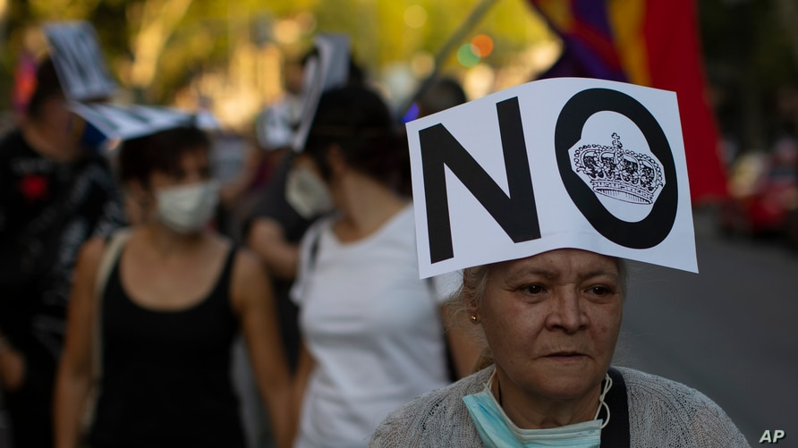 Demonstrators march during a protest against Spanish Monarchy in Madrid, Spain, Saturday, July 25, 2020.  A barrage of media…