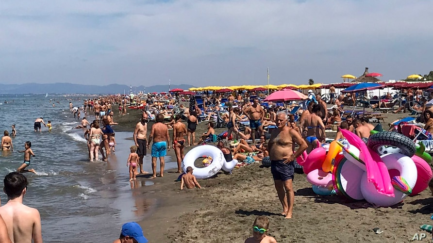 People enjoy the beach in Fregene, a fashionable sea resort some 30km (19 miles) north of Rome, July 26, 2020.
