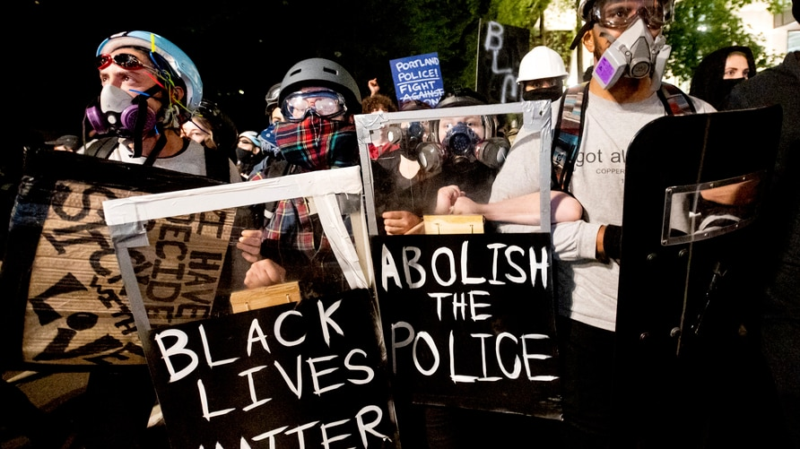 Black Lives Matter protesters march through Portland, Ore. after rallying at the Mark O. Hatfield United States Courthouse on…
