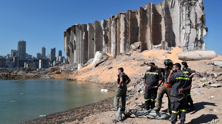 A rescue team surveys the site of this week's massive explosion in the port of Beirut, Lebanon, Friday, Aug. 7, 2020. Three…