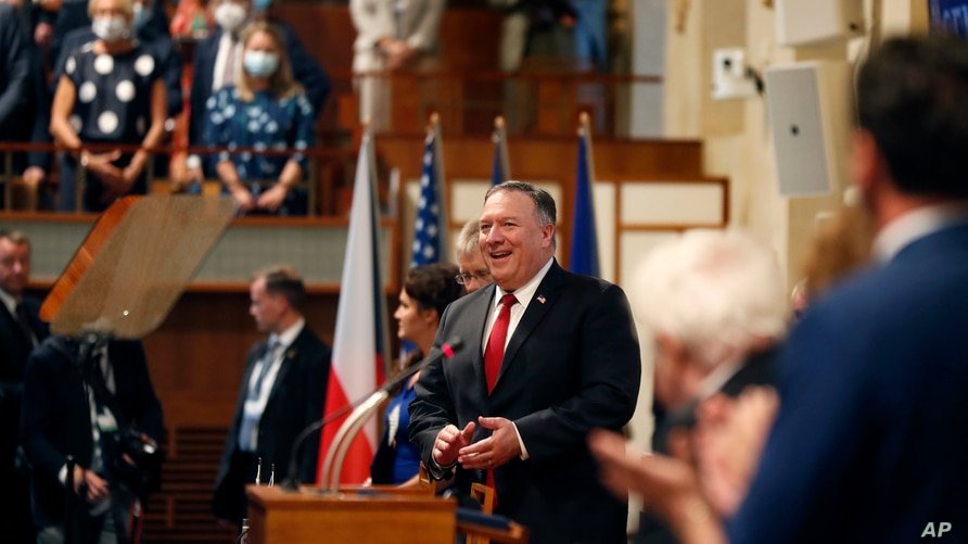 U.S. Secretary of State Mike Pompeo, center, smiles as he arrives for a meeting of the senate in Prague, Czech Republic,…
