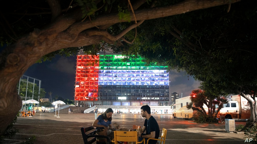 Tel Aviv City Hall is lit up with the flags of the United Arab Emirates and Israel as the countries announced they would be…
