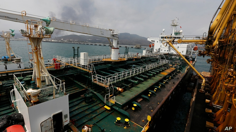 FILE - In this May 25, 2020 file photo, the Iranian oil tanker Fortune is anchored at the dock of the El Palito refinery near…