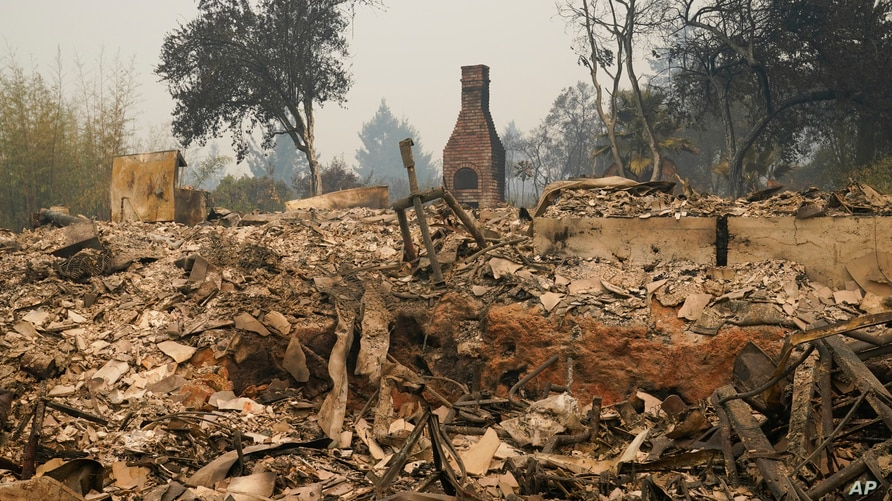 A chimney is left standing amid the ruins of a wildfire-ravaged home enveloped by the CZU August Lightning Complex Fire, Aug. 21, 2020, in Bonny Doon, Calif.