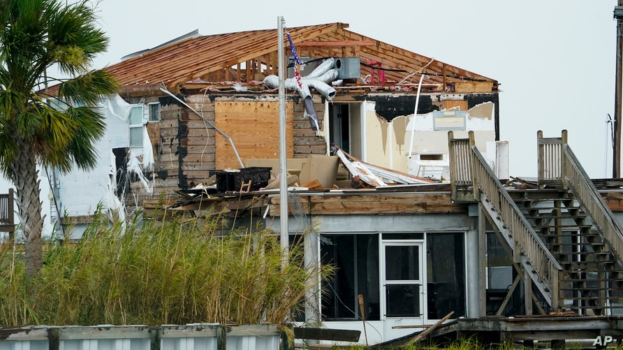 A damaged home is shown Friday, Aug. 28, 2020, in Hackberry, La., after Hurricane Laura move through the area Thursday.