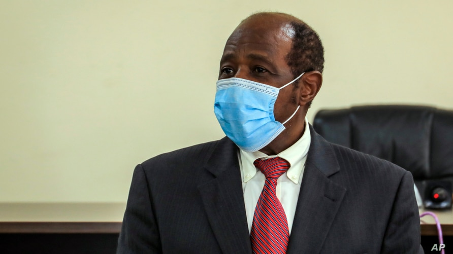 Paul Rusesabagina appears in front of media at the headquarters of the Rwanda Bureau of investigations building in Kigali, Rwanda, Aug. 31, 2020.