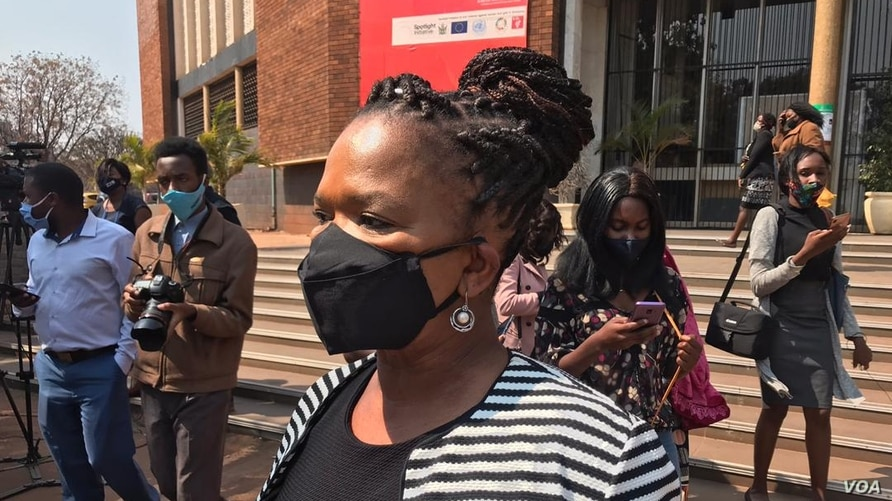 Beatrice Mtetwa, a member of Zimbabwe Lawyers of Human Rights, talks to reporters outside the Harare Magistrates Court in Harare, Zimbabwe, Aug. 18, 2020.