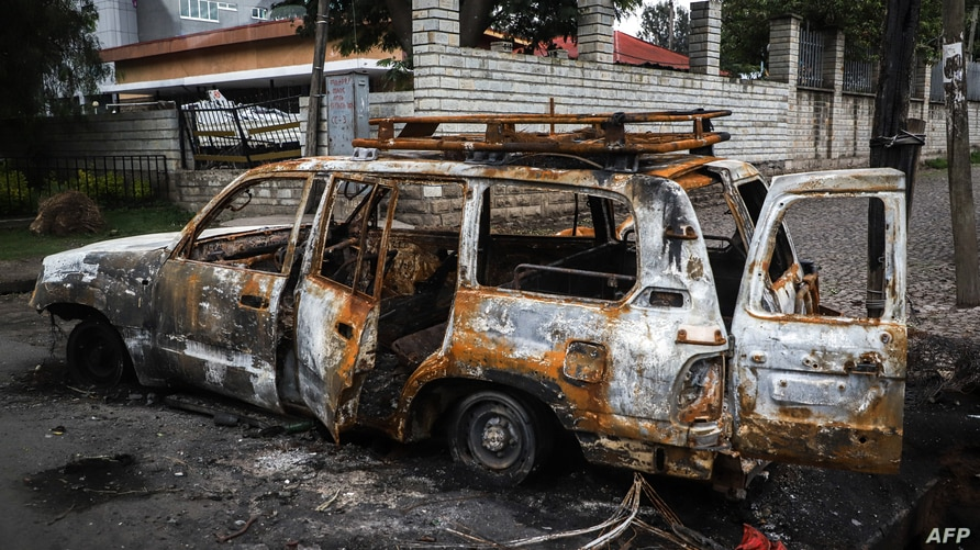 The remains of a burnt car which was set on fire by a mob during the violence after the assassination of Oromo's pop singer Hachalu Hundessa is seen in Shashamene, Ethiopia, July 12, 2020.