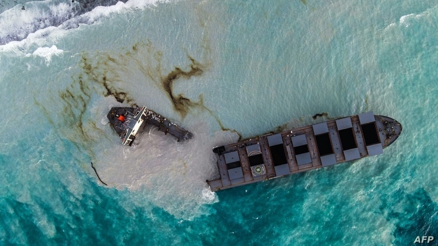 This aerial picture shows the MV Wakashio bulk carrier that had run aground and near Blue Bay Marine Park, Mauritius, splits into two.