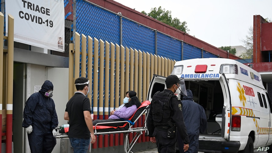 Paramedics move a patient suspected of having contracted the coronavirus, at a COVID-19 triage area at the General Hospital in Mexico City, Mexico, August 20, 2020.