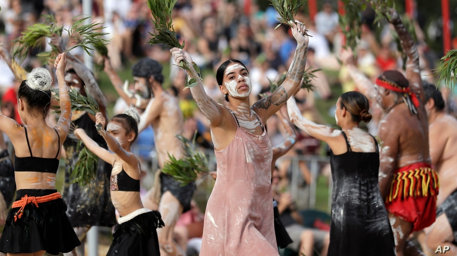 FILE - An Aboriginal dance troupe performs at Australia Day celebrations in Sydney, Australia, Jan. 26, 2020. Rap music has been employed as part of a new awareness campaign to educate Australia's indigenous population about the coronavirus.