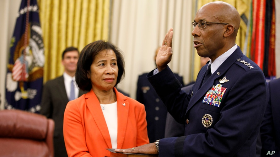 Gen. Charles Brown Jr., right, is sworn in as Chief of Staff of the Air Force in the Oval Office of the White House, with his wife Sharene Guilford Brown holding the Bible, in Washington, Aug. 4, 2020.