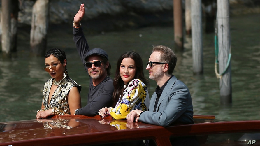 File - From Left: actors Ruth Negga, Brad Pitt, Liv Tyler and director James Gray arrive for the photo call of 'Ad Astra' at the Venice Film Festival, Aug. 29, 2019.