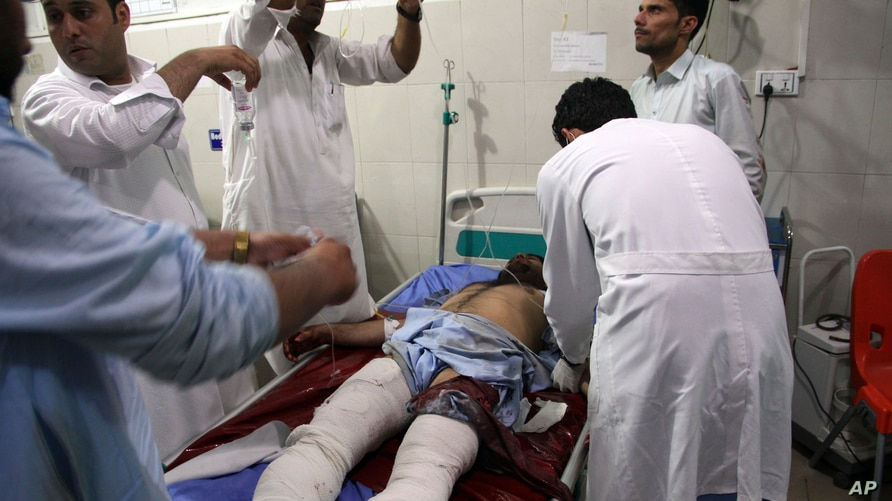 A wounded man receives treatment at a hospital after a suicide car bomb and multiple gunmen attack in the city of Jalalabad, east of Kabul, Afghanistan, Aug. 2, 2020.