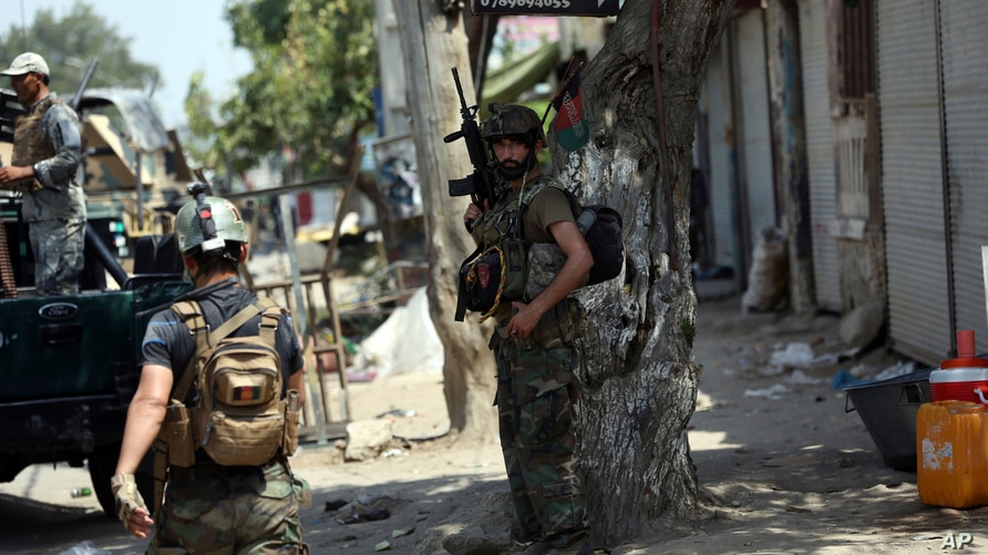 FILE - Members of Afghan security forces are seen during an operation in Jalalabad, Afghanistan, Aug. 3, 2020. Clashes in different parts of the country and a roadside bomb have killed about three dozen people Thursday.