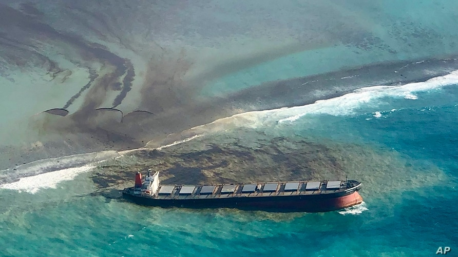 This photo taken and provided by Eric Villars shows oil leaking from the MV Wakashio, a bulk carrier ship that recently ran aground off the southeast coast of Mauritius, Aug. 7, 2020.
