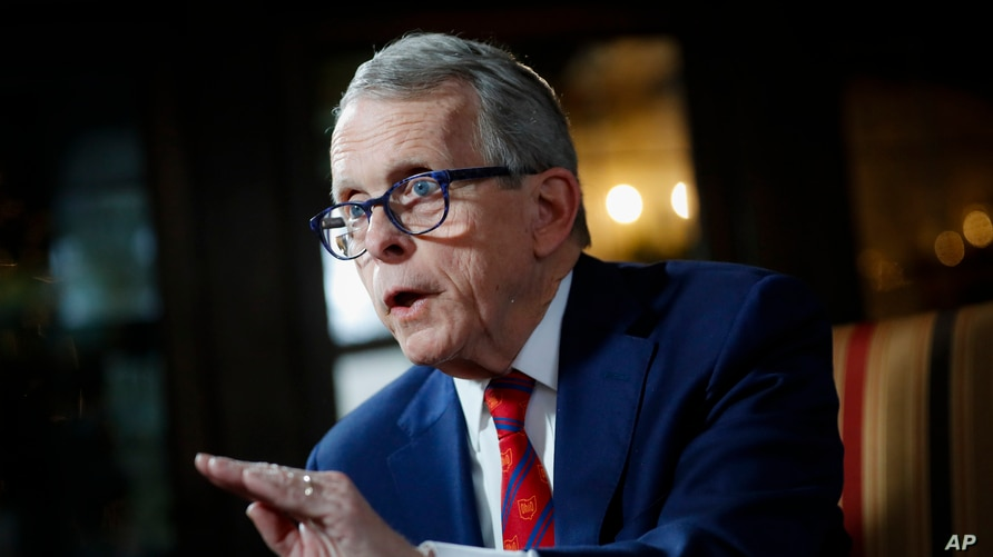 FILE - Ohio Governor Mike DeWine speaks during an interview at the Governor's Residence in Columbus, Ohio, Dec. 13, 2019.