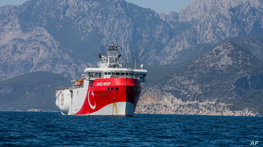 FILE - Turkey's exploratory vessel, the Oruc Reis, is seen anchored in the Mediterranean, off the coast of Antalya, Turkey, July 24, 2020.