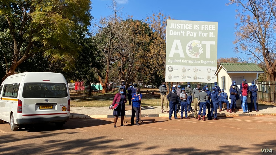 FILE - Zimbabwe authorities have maintained a heavy police presence to thwart any possible anti-government protests during the mandated COVID 19 lockdown, in Harare, July 22, 2020.
