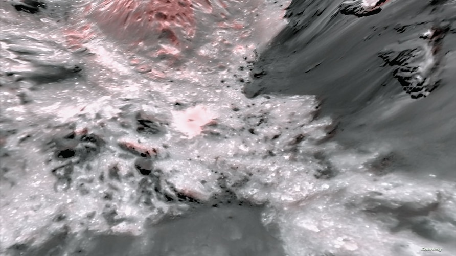 This mosaic image uses false color to highlight the recently exposed brine, or salty liquids, that were pushed up from a deep reservoir under Ceres' crust. In this view of a region of Occator Crater, they appear reddish. (Credits: NASA)