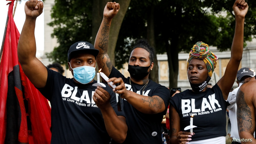 People react while gathering for a vigil, following the police shooting of Jacob Blake, a Black man, in Kenosha, Wisconsin, Aug. 28, 2020.