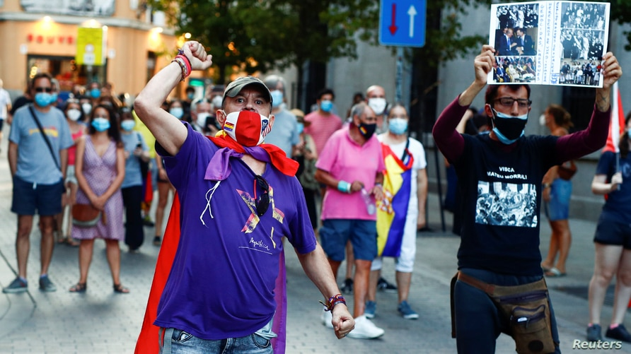 Protesters march against Spain's monarchy for the first time since former Spanish King Juan Carlos left the country amid an investigation into his involvement in a high-speed rail contract in Saudi Arabia, in Madrid, Spain Aug. 9, 2020.