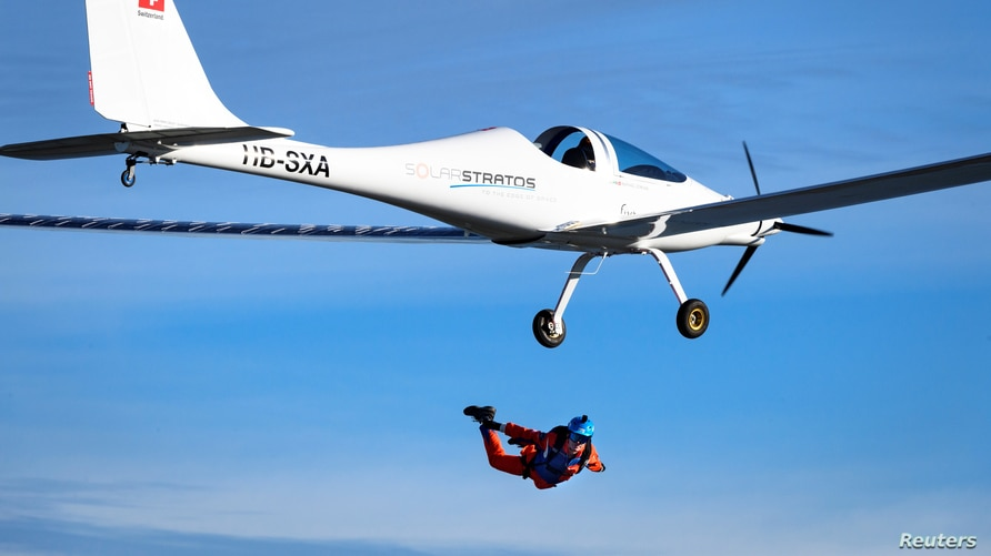 Swiss adventurer Raphael Domjan jumps from the SolarStratos solar-powered aircraft prototype with Spanish test pilot Miguel  Iturmendi aboard, at the airbase in Payerne, Switzerland, Aug. 25, 2020.